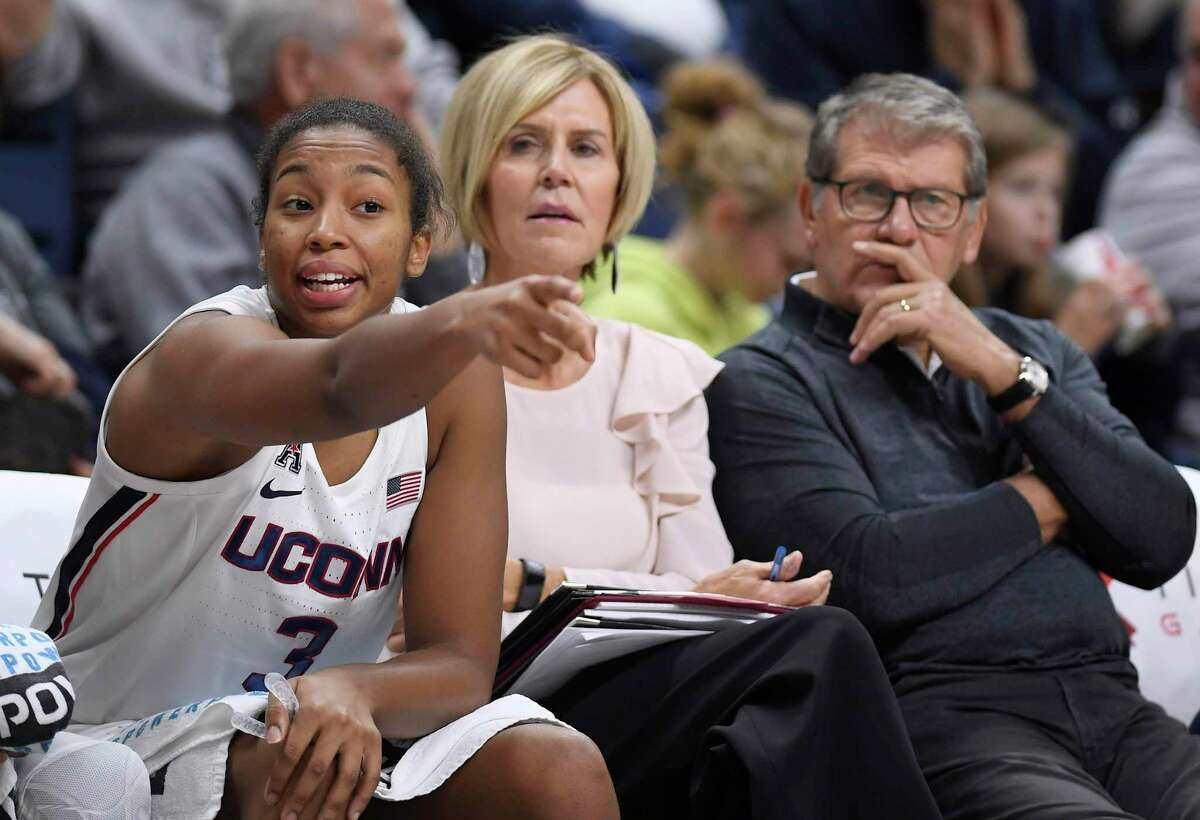 UConn's Megan Walker, left, gestures to her team as associate head coach Chris Dailey, center, and coach Geno Auriemma look on during a Nov. 3 exhibition game against Jefferson.