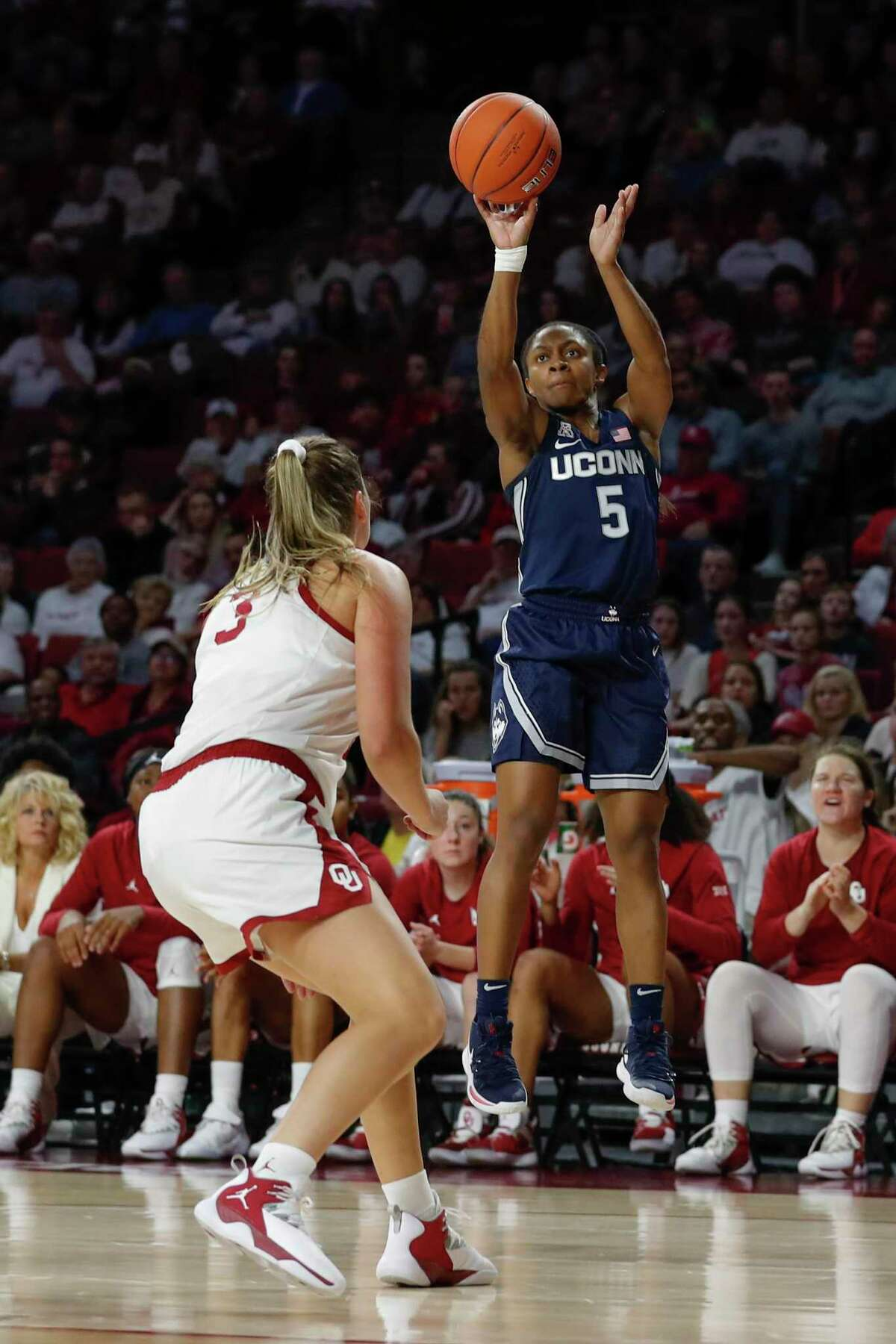 UConn's Crystal Dangerfield shoots over Oklahoma's Mandy Simpson on Dec. 19, 2018. The Sooners put a scare into the Huskies last season, as Dangerfield recalled.