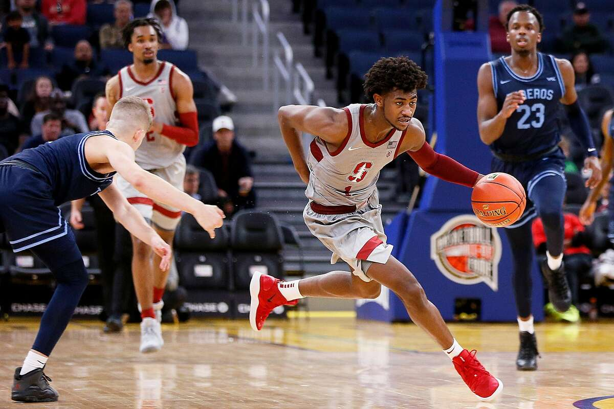 Stanford Cardinal guard Daejon Davis (1) dribbles past San San Diego Toreros guard Joey Calcaterra (2) in Session 1 of the Al Attles Classic at Chase Center on Saturday, Dec. 21, 2019, in San Francisco, Calif.