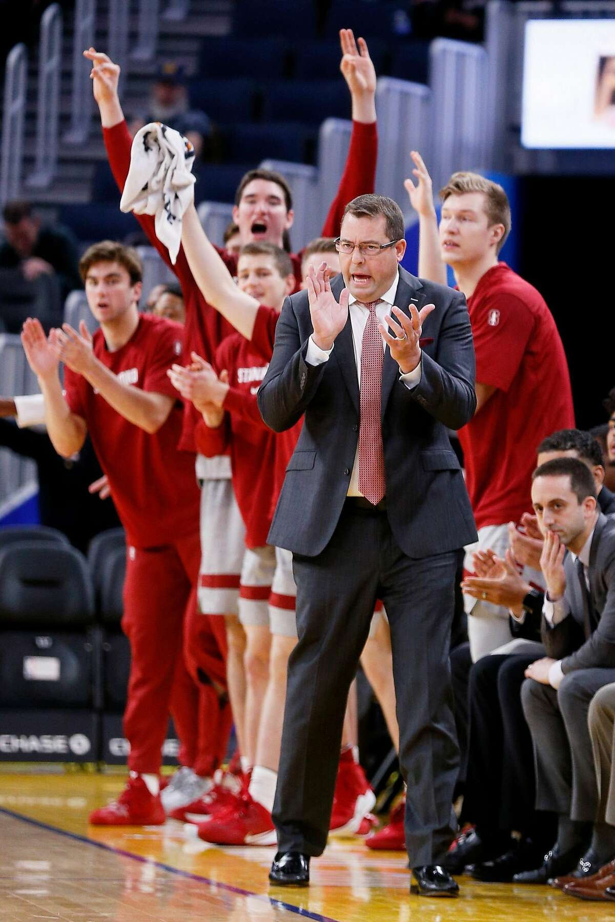Stanford Cardinal head coach Jerod Haase and the bench cheer as the Cardinal score against the San Diego Toreros in Session 1 of the Al Attles Classic at Chase Center on Saturday, Dec. 21, 2019, in San Francisco, Calif.