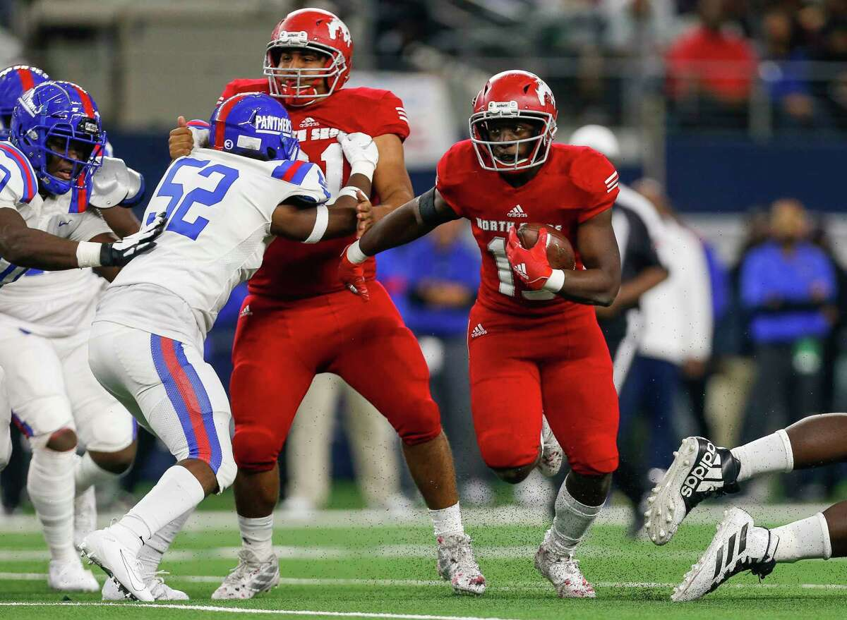PHOTOS: North Shore vs. Duncanville  North Shore running back Roger Hagan (15) runs the ball against Duncanville during the first quarter of the UIL 6A Division 1 State Championship at AT&T Stadium Saturday, Dec. 21, 2019, in Arlington, Texas.