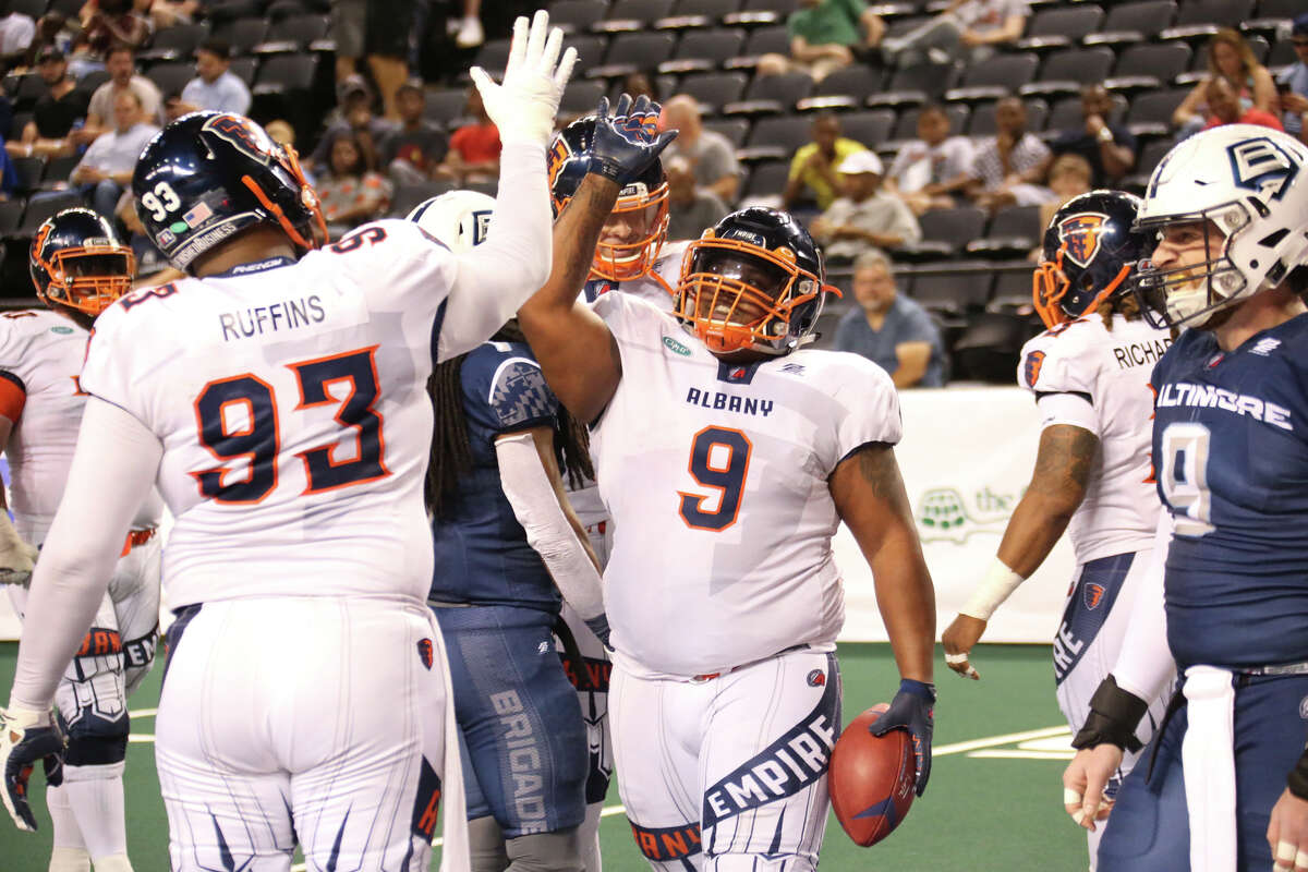 Albany running back Mykel Benson celebrates his 2-yard touchdown run with teammate Moqut Ruffins in the Empire's 62-21 victory on Saturday, Aug. 3, 2019, in the second game of their two-game aggregate score playoff series against Baltimore. (Ned Dishman / Arena Football League)