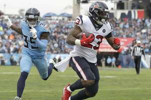 Houston Texans running back Carlos Hyde (23) gets past Tennessee Titans cornerback Tramaine Brock Sr. (35) in the second half of an NFL football game Sunday, Dec. 15, 2019, in Nashville, Tenn. (AP Photo/James Kenney)