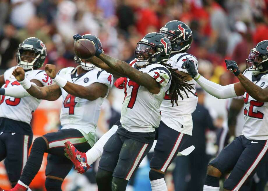 Houston Texans strong safety Jahleel Addae (37), center, celebrates a fourth quarter interception with teammates Saturday, Dec. 21, 2019 in Tampa. The Buccaneers lost 23-20. Photo: DOUGLAS R. CLIFFORD, MBR / TNS / Tampa Bay Times