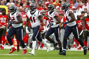 Houston Texans inside linebacker Zach Cunningham (41) runs off the field with his teammates as he celebrates picking up a blocked field goal attempt by the Tampa Bay Buccaneers during the first quarter of an NFL football game at Raymond James Stadium on Saturday, Dec. 21, 2019, in Tampa.