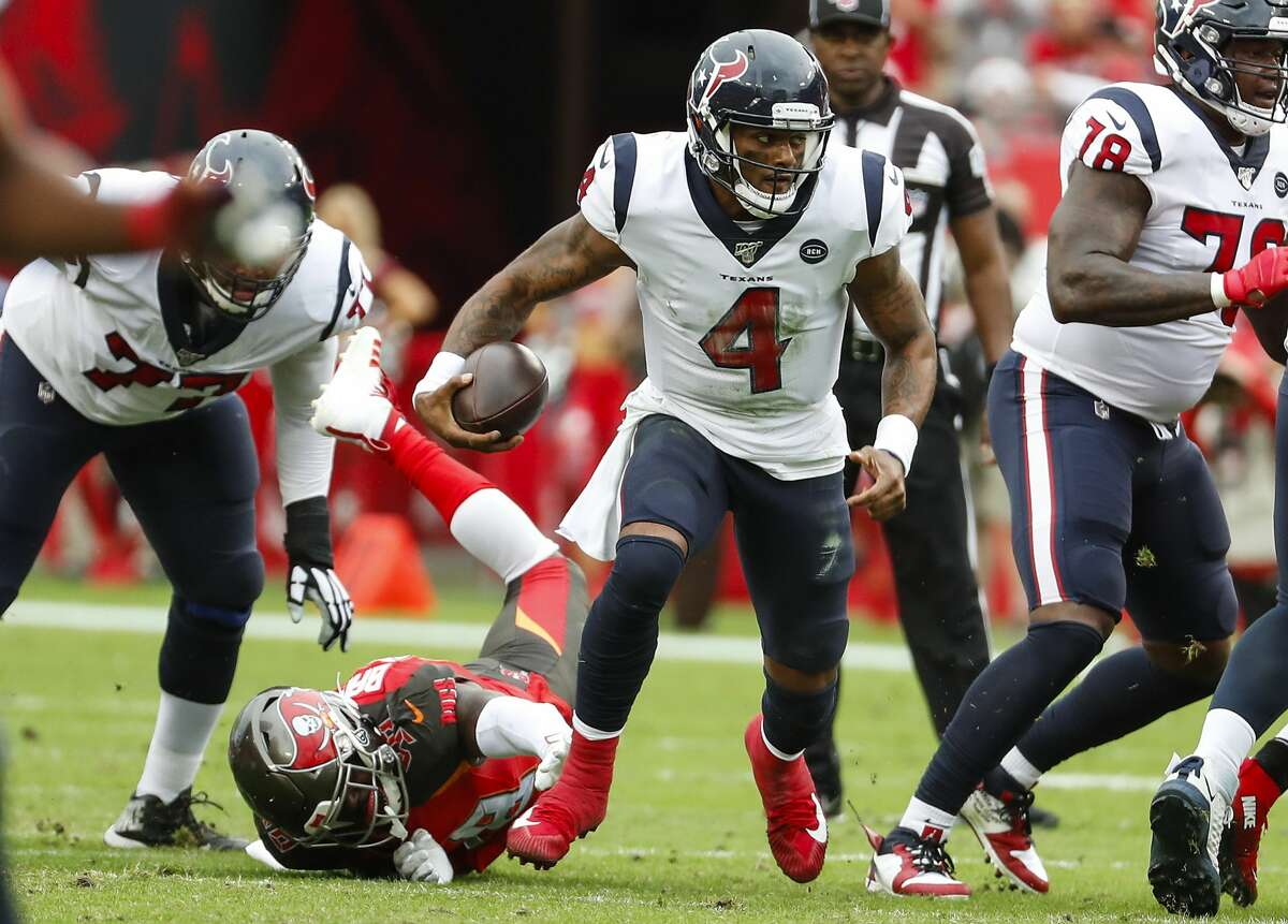 Houston Texans quarterback Deshaun Watson (4) breaks out of the pocket away from Tampa Bay Buccaneers linebacker Anthony Nelson (98) and runs for a first down during the third quarter of an NFL football game at Raymond James Stadium on Saturday, Dec. 21, 2019, in Tampa.