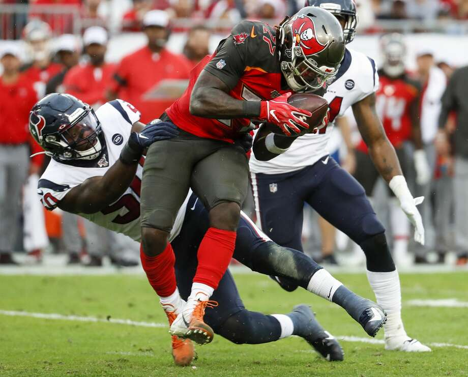 Houston Texans linebacker Tyrell Adams (50) hits Tampa Bay Buccaneers running back Ronald Jones (27) after he made a catch during the fourth quarter of an NFL football game at Raymond James Stadium on Saturday, Dec. 21, 2019, in Tampa. Photo: Brett Coomer/Staff Photographer