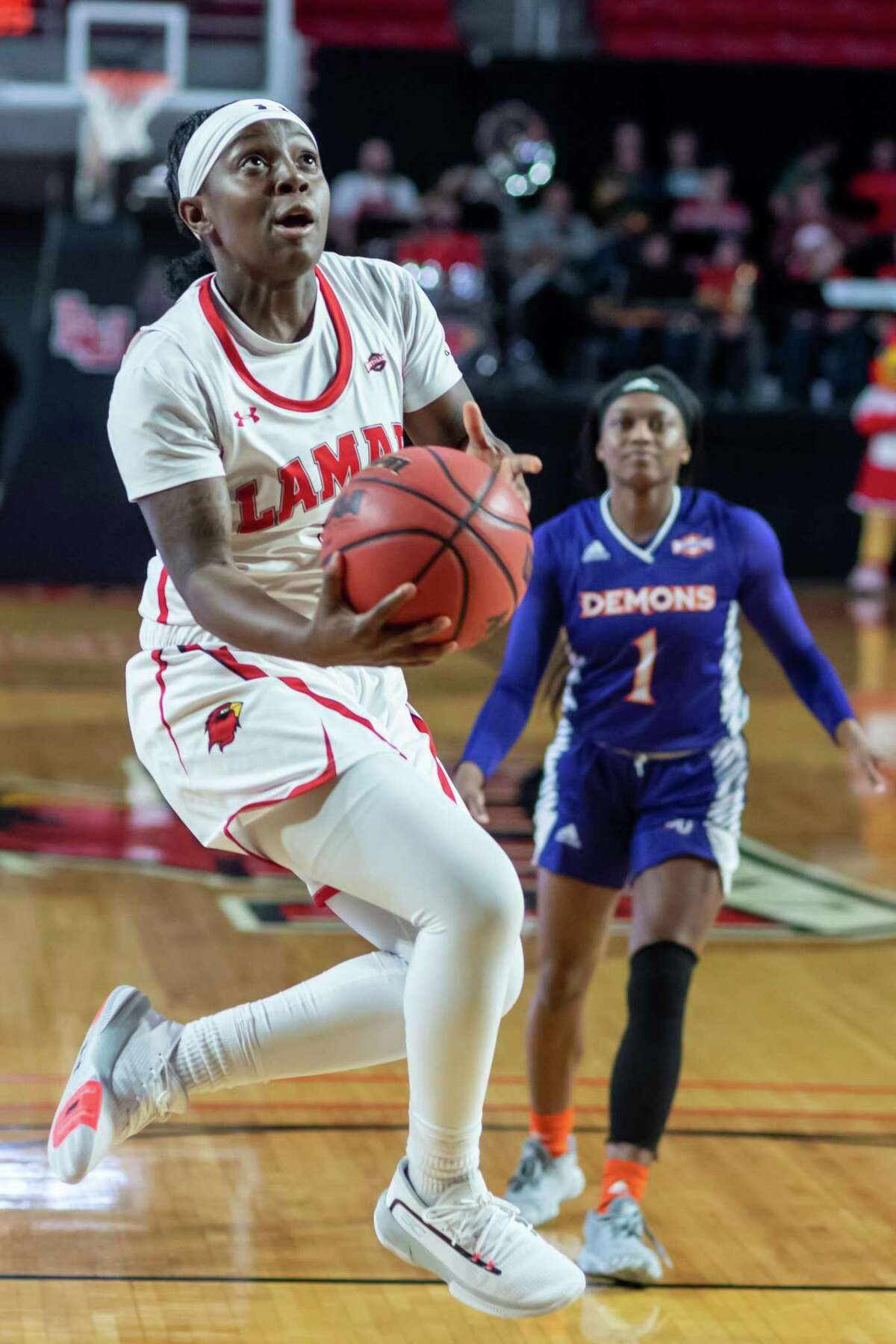 Angel Hastings (2) puts up an underhand shot under the basket as the Lady Cardinals took down the Demons of Northwestern State by a score of 61-58 on Saturday, December 21, 2019. Fran Ruchalski/The Enterprise