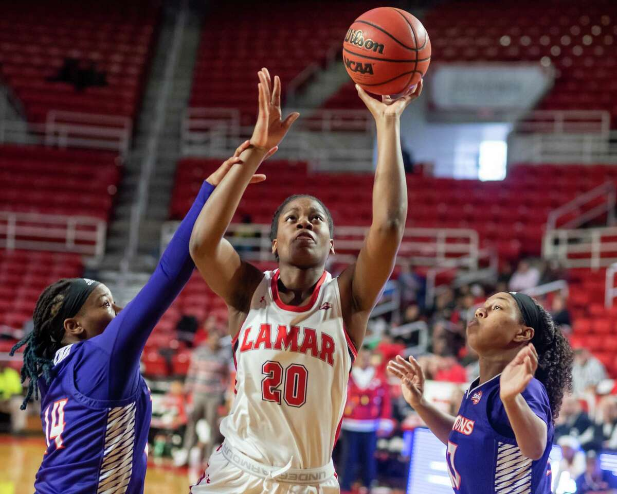 Rikiah Coward (20) puts up a shot under the basket as the Lady Cardinals took down the Demons of Northwestern State by a score of 61-58 on Saturday, December 21, 2019. Fran Ruchalski/The Enterprise