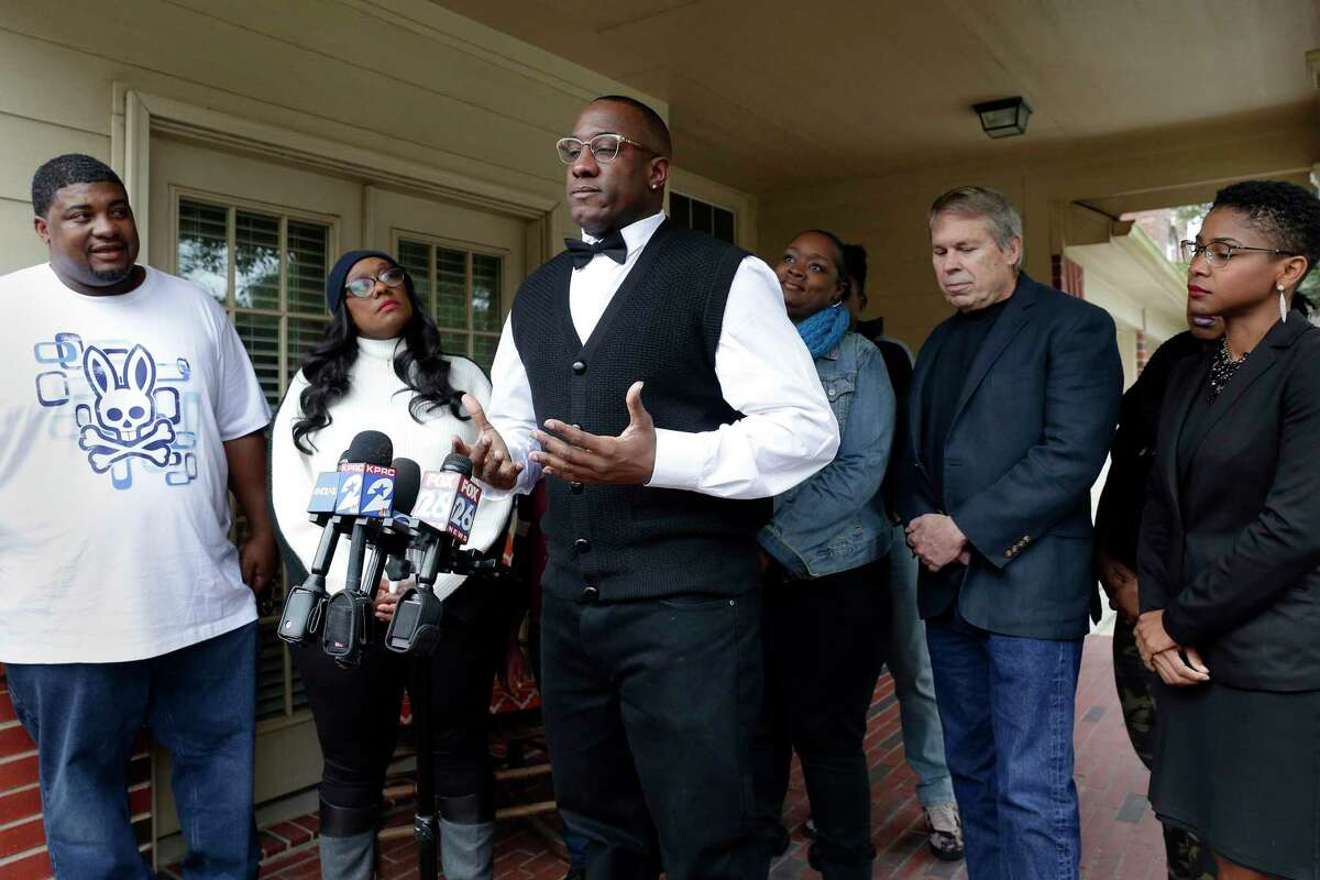 Lydell Grant, center, surrounded by family and his legal team, speaks about his release and pending exoneration for the murder of Aaron Scheerhoorn during a press conference at his family's Bear Creek home Saturday, Dec. 21, 2019 in Houston, TX.