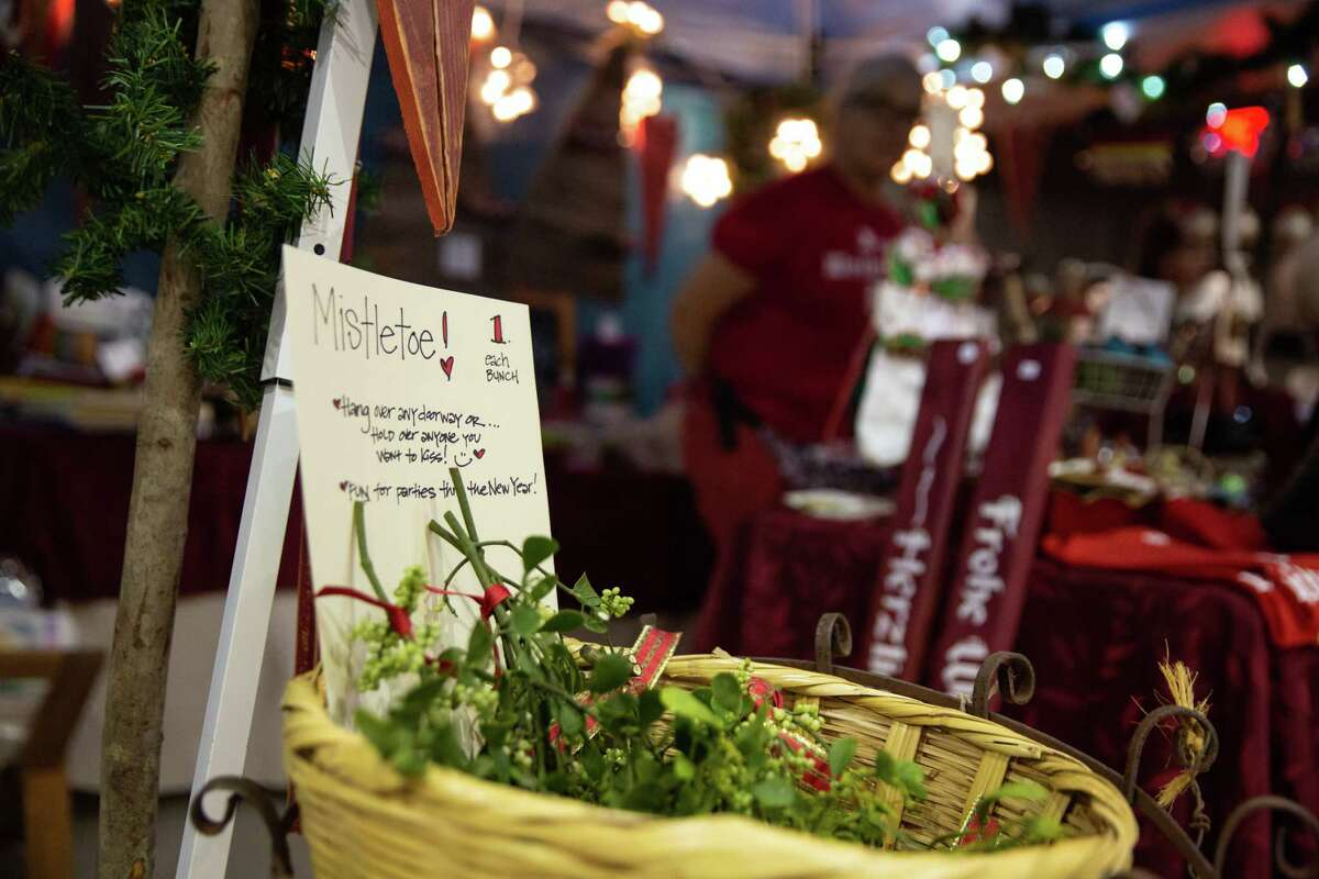 A basket of mistletoes are on display in front of Lindee's crafts at the German Christmas Market on Dec. 21, 2019.