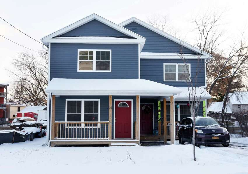 Homes at 26 and 28 Cherry Street built by Habitat for Humanity on Wednesday, Dec. 18, 2019, in Saratoga Springs, N.Y. (Will Waldron/Times Union)