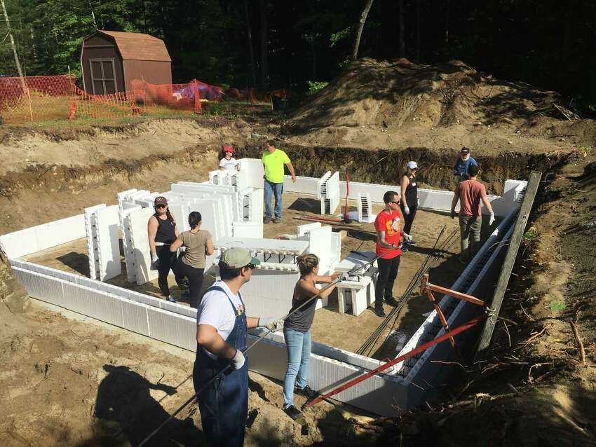 Volunteers for Habitat for Humanity of Northern Saratoga, Warren and Washington County work on a house in Lake George (Photo provided)