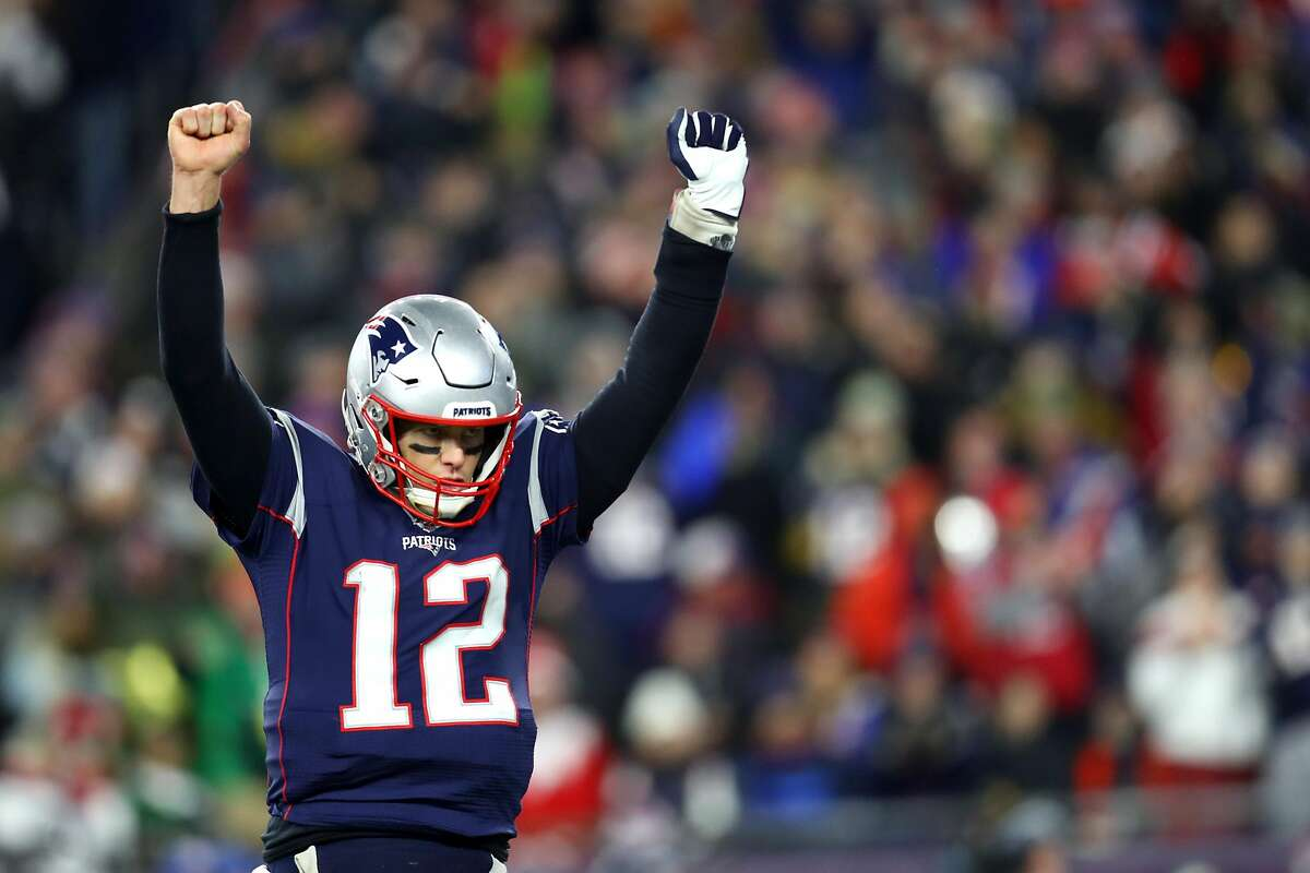 FOXBOROUGH, MASSACHUSETTS - DECEMBER 21: Tom Brady #12 of the New England Patriots celebrates after Rex Burkhead #34 scored a touchdown against the Buffalo Bills in the fourth quarter at Gillette Stadium on December 21, 2019 in Foxborough, Massachusetts. The Patriots defeat the Bills 24-17. (Photo by Maddie Meyer/Getty Images)