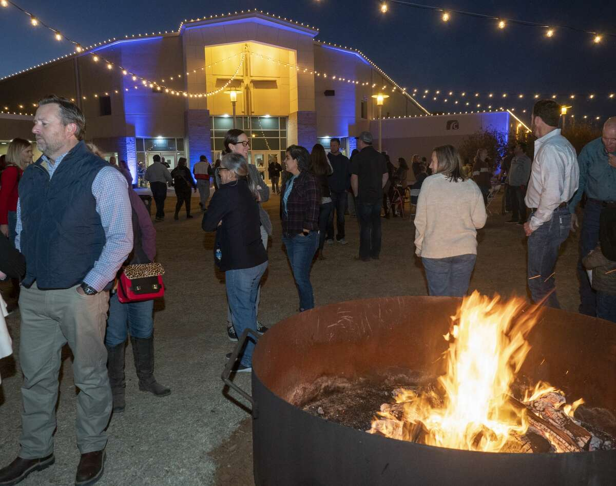 Family and friends gather 12/21/19 at Christmas at Stonegate, a free event Saturday and Sunday evening with outdoor activities including lawn games, fire pits, West Texas style ice skating and hay rides to see Christmas lights, as well as a Christmas service inside. Tim Fischer/Reporter-Telegram
