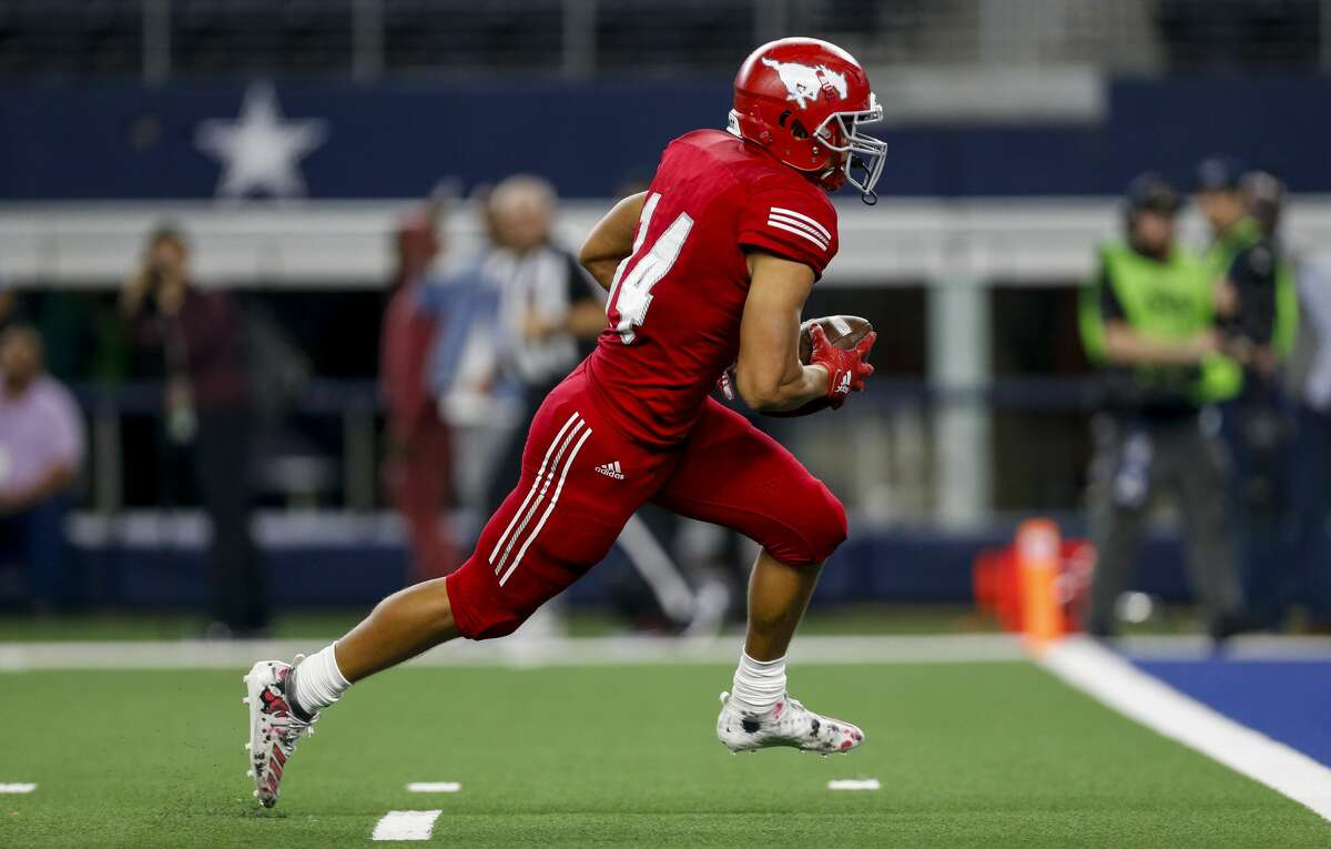 North Shore wide receiver Charles King (14) scores a receiving touchdown against Duncanville during the fourth quarter of the UIL 6A Division 1 State Championship at AT&T Stadium Saturday, Dec. 21, 2019, in Arlington, Texas. North Shore won 31-17.