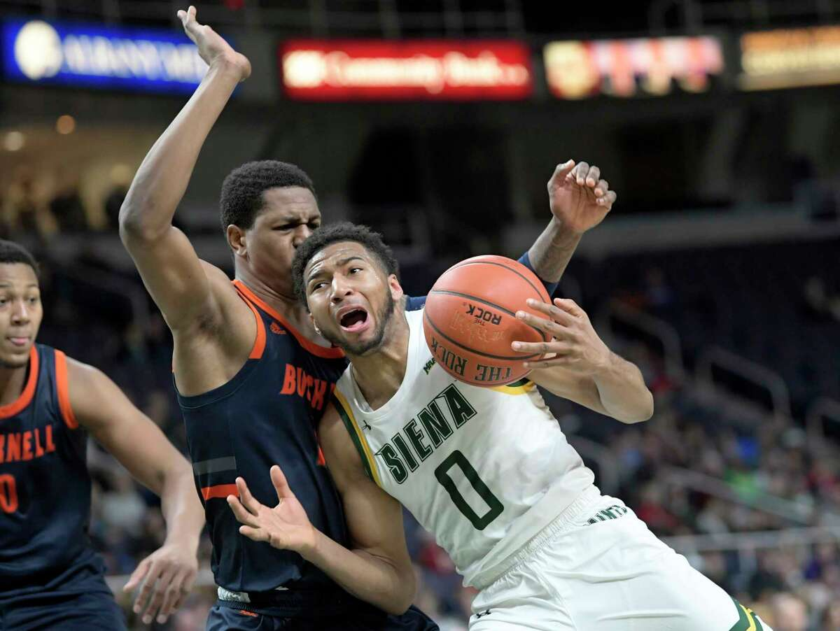 Bucknell forward Bruce Moore (13) defends against Siena guard Donald Carey (0) during the second half of an NCAA basketball game Saturday, Dec. 21, 2019, in Albany, N.Y. Siena won 81-71. (Hans Pennink / Special to the Times Union) ORG XMIT: 122219_siena_HP104