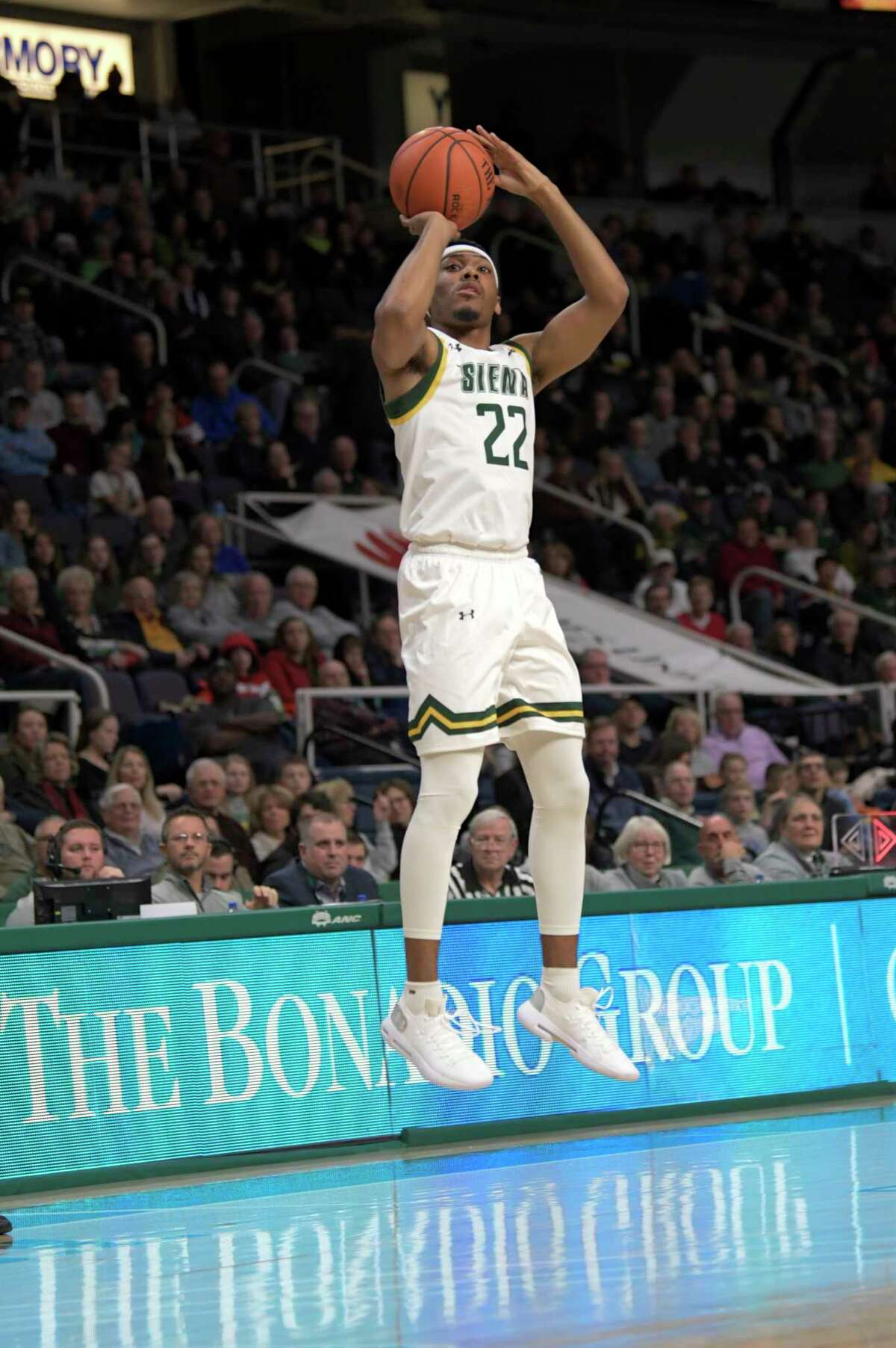 Siena guard Jalen Pickett (22) scores against Bucknell during the first half of an NCAA basketball game Saturday, Dec. 21, 2019, in Albany, N.Y. (Hans Pennink / Special to the Times Union) ORG XMIT: 122219_siena_HP107