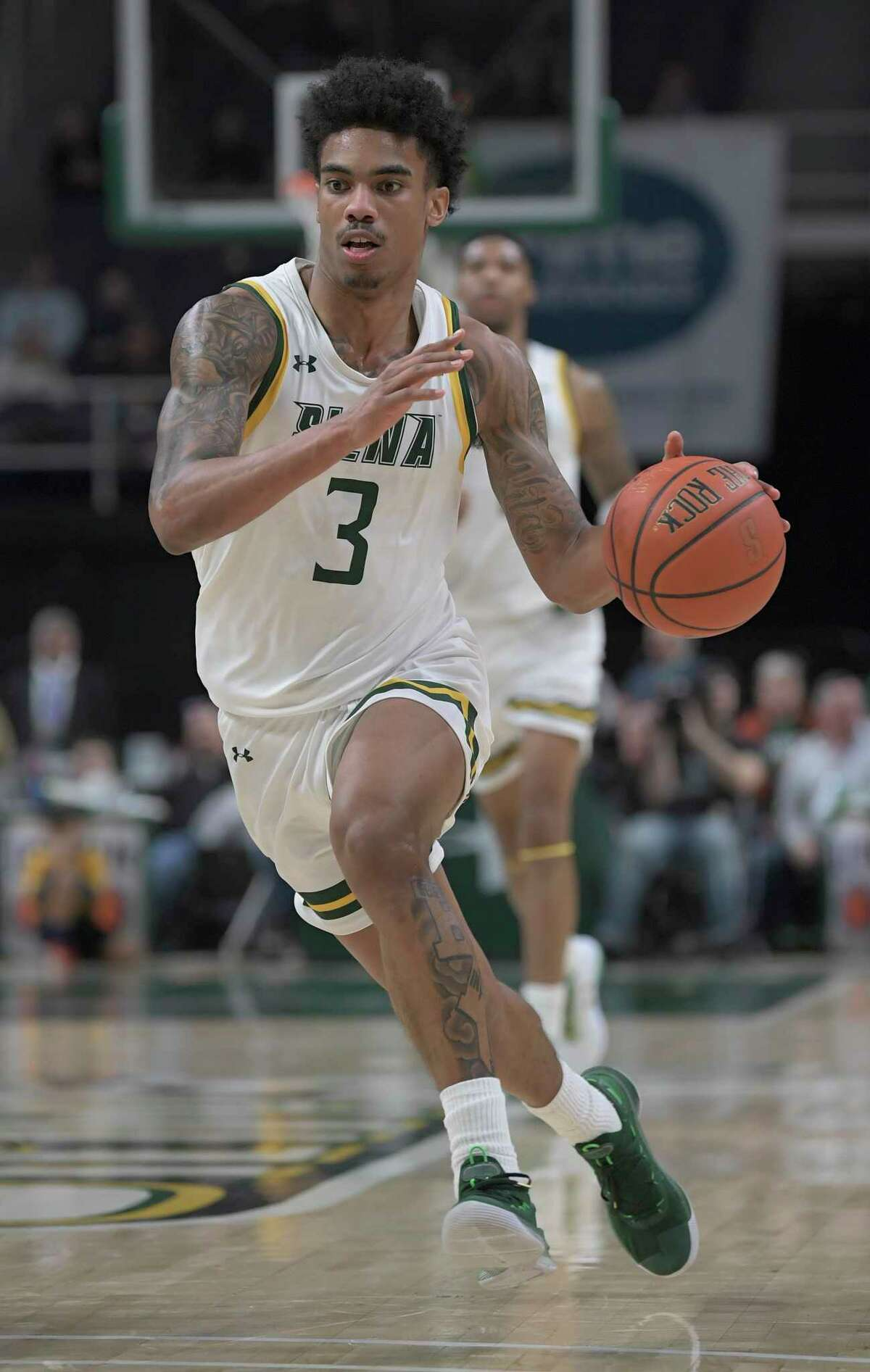Siena guard Manny Camper (3) moves the ball against Bucknell during the first half of an NCAA basketball game Saturday, Dec. 21, 2019, in Albany, N.Y. (Hans Pennink / Special to the Times Union) ORG XMIT: 122219_siena_HP115
