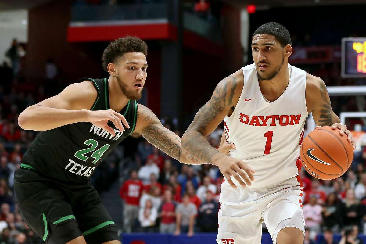 DAYTON, OHIO - DECEMBER 17: Obi Toppin #1 of the Dayton Flyers drives to the basket while being guarded by Zachary Simmons #24 of the North Texas Mean Green during the second half at UD Arena on December 17, 2019 in Dayton, Ohio. (Photo by Justin Casterline/Getty Images)