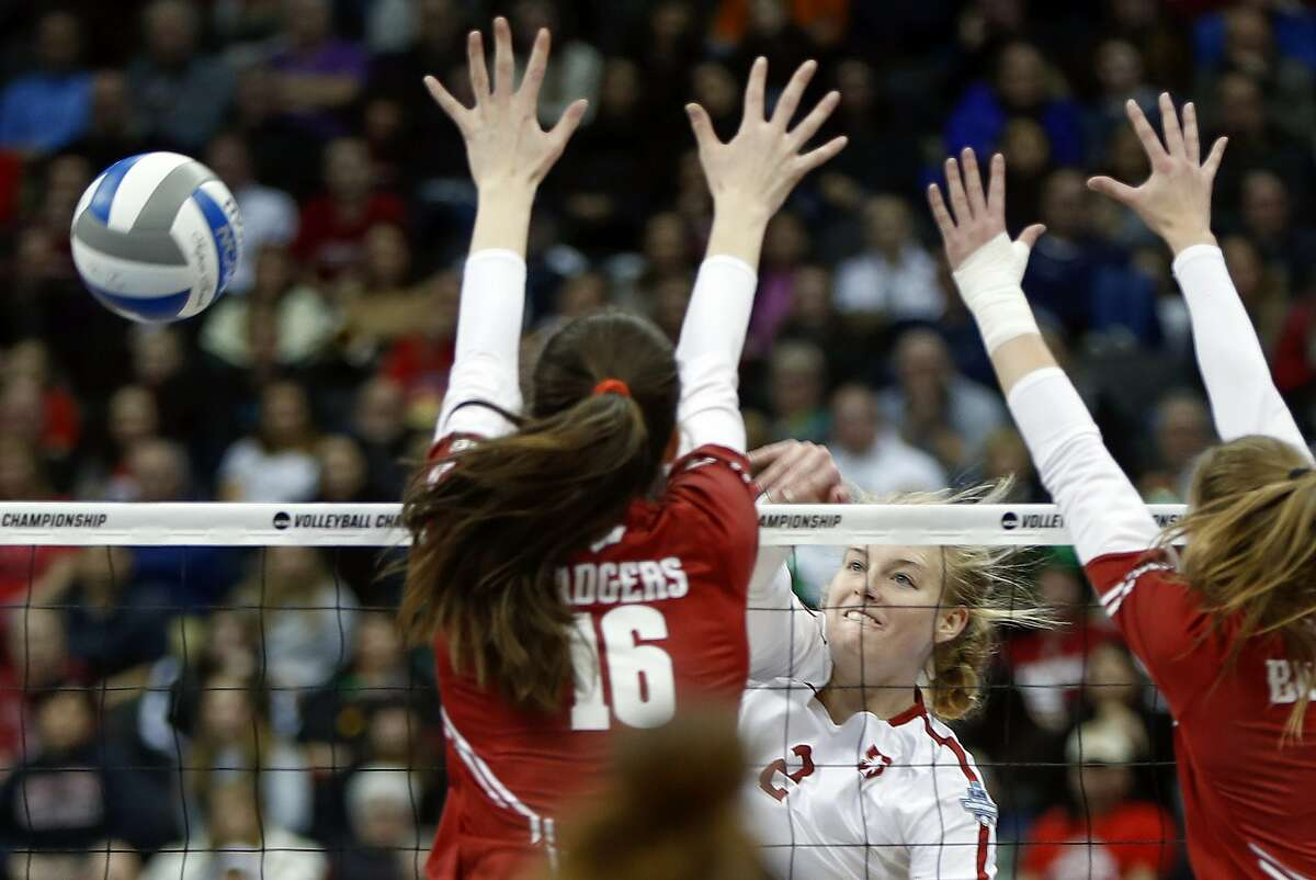 Stanford's Kathryn Plummer (2) spikes around the block by Wisconsin's Dana Rettke (16) during the NCAA Division I women's volleyball championship match, Saturday, Dec. 21, 2019, in Pittsburgh. (AP Photo/Keith Srakocic)