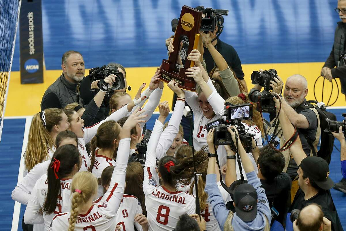The Stanford women's volleyball team holds the championship trophy after defeating Wisconsin for the NCAA Division I women's volleyball championship, Saturday, Dec. 21, 2019, in Pittsburgh. (AP Photo/Keith Srakocic)