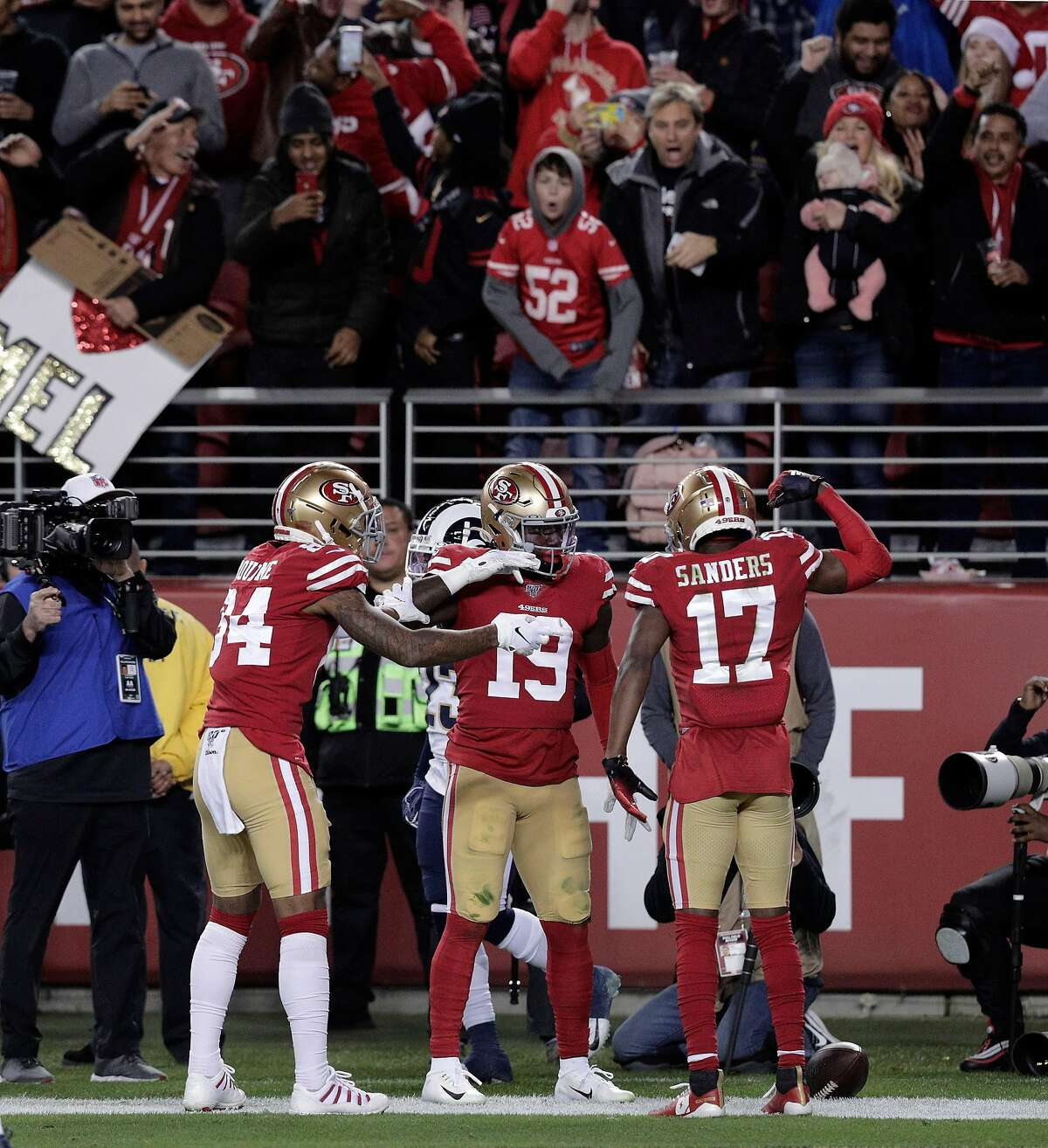 Kendrick Bourne (84), Deebo Samuel (19) and Emmanuel Sanders (17) celebrate Samuel's touchdown in the first half as the San Francisco 49ers played the Los Angeles Rams at Levi's Stadium in Santa Clara, Calif., on Saturday, December 21, 2019.