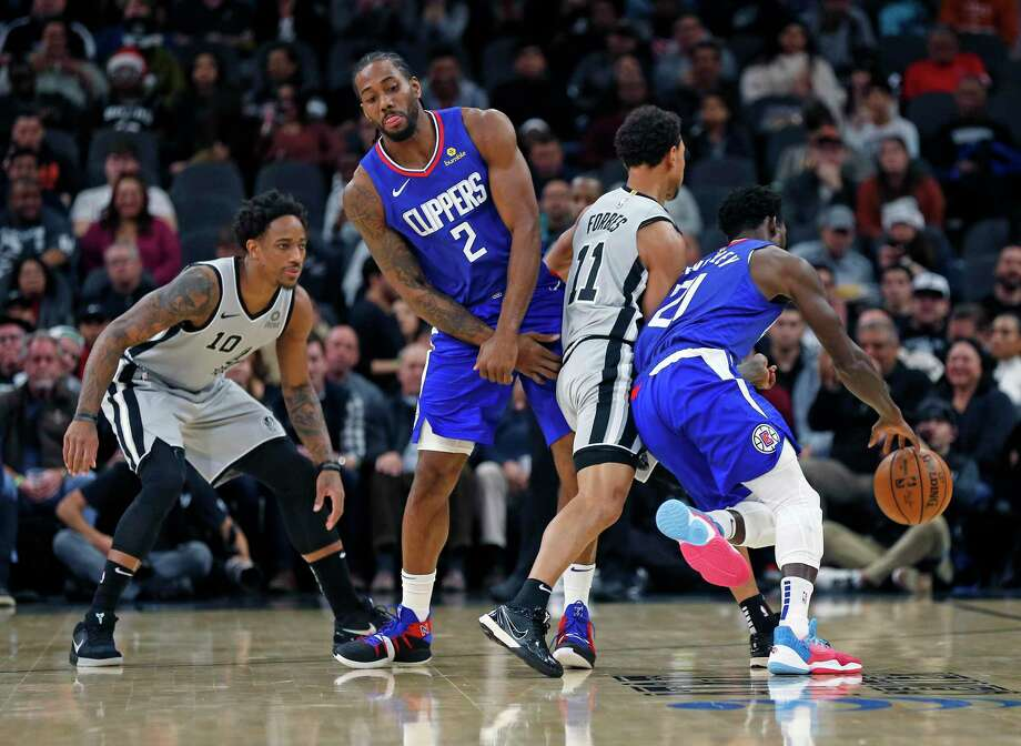 Kawhi Leonard #2 #2 of the Los Angeles Clippers tries to set a screen on Bryn Forbes #11 of the San Antonio Spurs in first half action on Saturday, December 21, 2019 Photo: Ronald Cortes/Contributor / 2019 Ronald Cortes