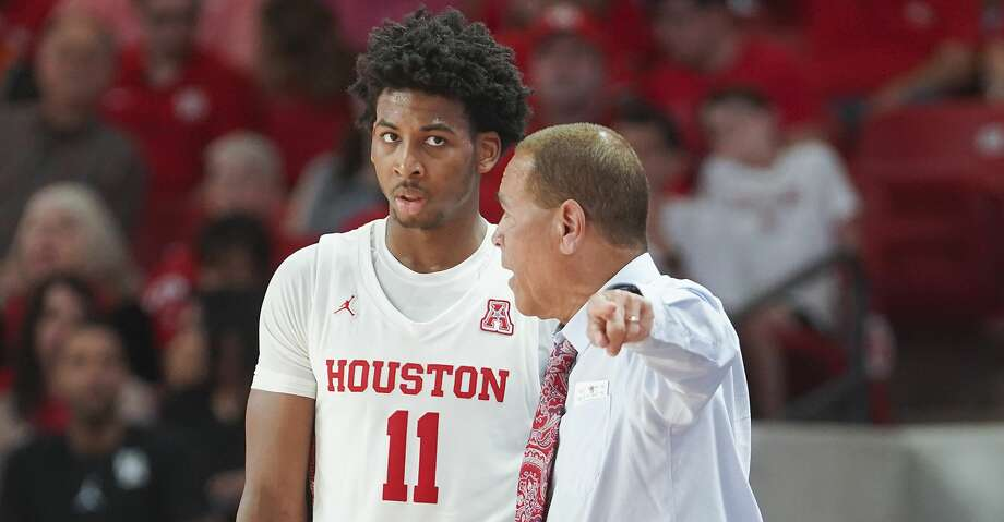 Houston Cougars head coach Kelvin Sampson gives some instruction to Houston Cougars guard Nate Hinton (11) in the first half against Oklahoma State Cowboys at Fertitta Center on Sunday, Dec. 15, 2019 in Houston. Photo: Elizabeth Conley/Staff Photographer
