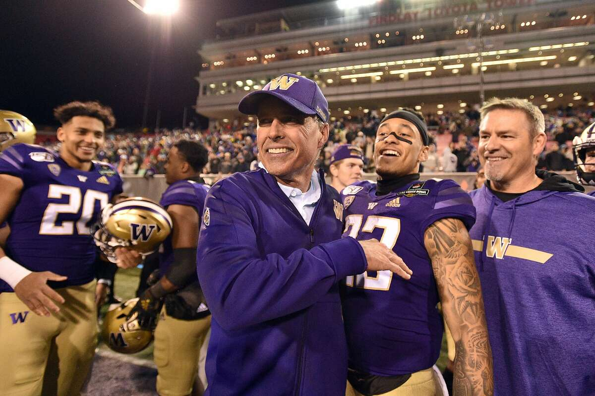 LAS VEGAS, NEVADA - DECEMBER 21: Head coach Chris Petersen (C) of the Washington Huskies celebrates with his team after defeating the Boise State Broncos 38-7 in the Mitsubishi Motors Las Vegas Bowl at Sam Boyd Stadium on December 21, 2019 in Las Vegas, Nevada. (Photo by David Becker/Getty Images)