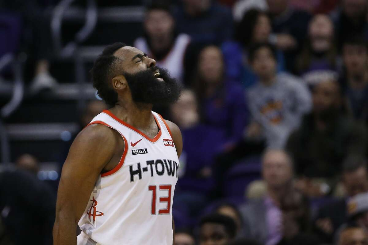 Houston Rockets guard James Harden celebrates one of his three-point baskets against the Phoenix Suns during the second half of an NBA basketball game Saturday, Dec. 21, 2019, in Phoenix. (AP Photo/Ross D. Franklin)