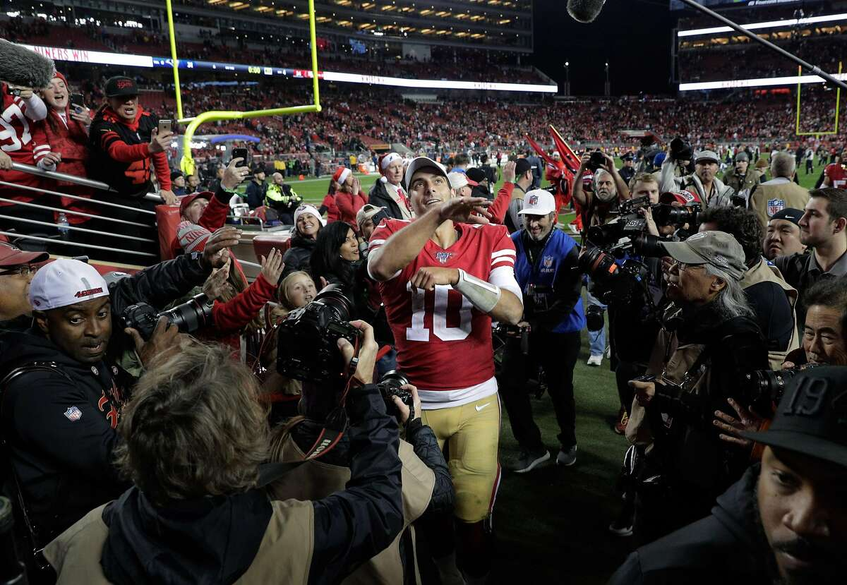 Jimmy Garoppolo (10) throws some equipment to a fan after the San Francisco 49ers defeated the Los Angeles Rams 34-31 at Levi's Stadium in Santa Clara, Calif., on Saturday, December 21, 2019.