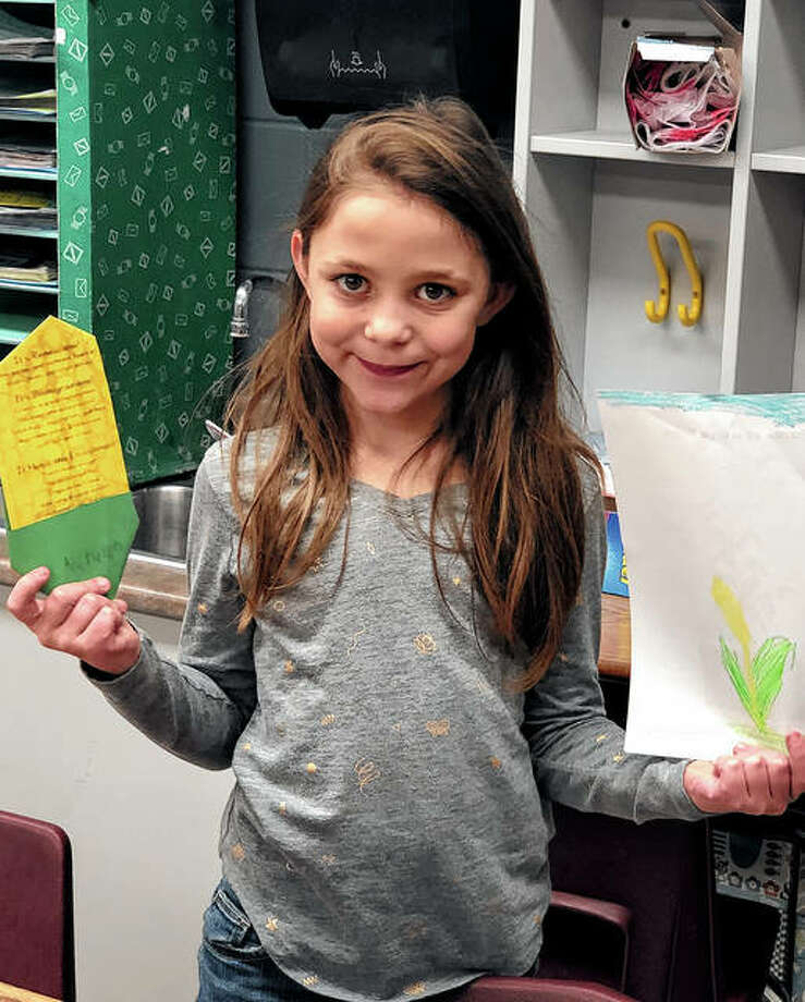 The Pike-Scott Agriculture in the Classroom program recently visited Western Elementary School to teach third-graders there about corn. Autumn Little, a student in Mrs. Hoskins' class, showed her completed corn crafts. Photo: Photo Provided