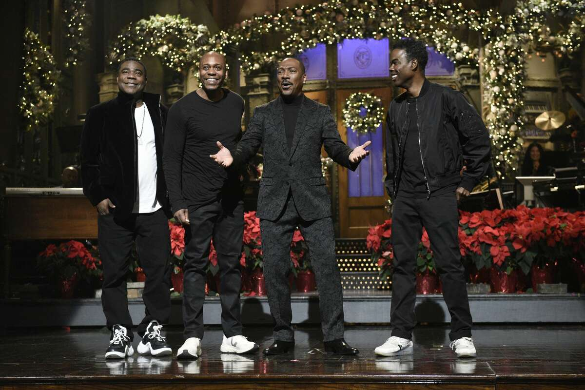 Tracy Morgan, Dave Chappelle, host Eddie Murphy, and Chris Rock during the monologue on Saturday, December 21, 2019.