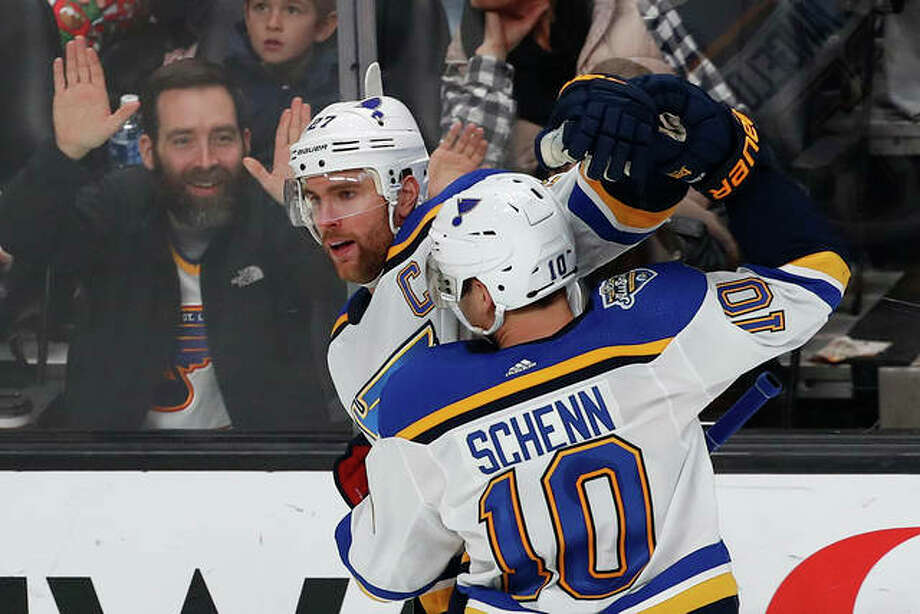 The Blues' Alex Pietrangelo celebrates with Brayden Schenn (10) after scoring a goal against the Sharks during the third period Saturday night in San Jose, Calif. Photo: Associated Press
