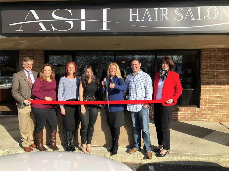 From left, Mark Barnhart, Director of Community & Economic Development; Sarah Dobrosky, Master Stylist; Kelley O'Connell Mallozzi, Master Stylist; Kat Viera, Owner / Master Colorist & Stylist; Brenda Kupchick, First Selectwoman; Wilson Viera, Owner; Beverly Balaz, President Fairfield Chamber of Commerce. Photo: Contributed Photo