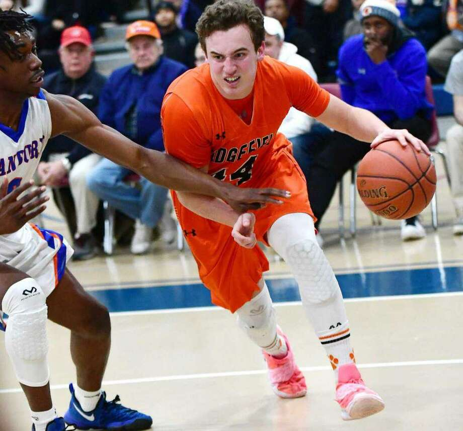 Chris Knachel (shown in last season's FCIAC championship game victory) had 15 points and eight rebounds as Ridgefield beat Fairfield Prep, 75-53, Saturday night. Photo: Erik Trautmann / Hearst Connecticut Media