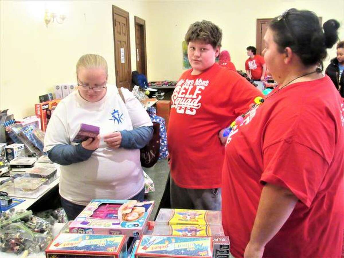 Mid-Town Moms members helping out with the shopping. About 3,000 toys were donated in total.