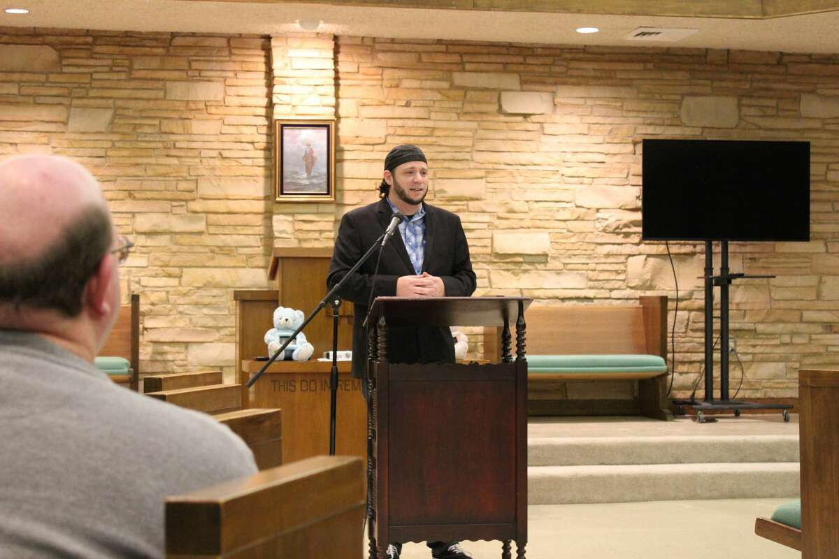 Caption: Mark Lee Dickson, director of Right to Life of East Texas, speaks before a crowd gathered at First Baptist Church in Big Spring to discuss an ordinance that would outlaw abortion in the city.
