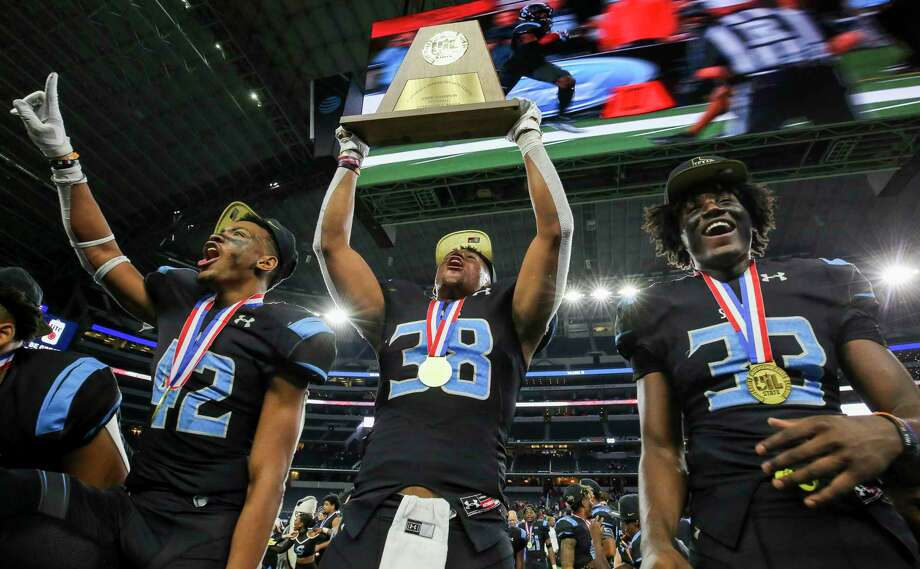 Shadow Creek players Byron Roberson, Terreance Ellis and Terrance Cooks celebrate after winning the 5A Division 1 state championship last year. The Sharks are pegged to win District 23-6A this year by Dave Campbell's Texas Football Magazine. Photo: Godofredo A. Vásquez, Houston Chronicle / Staff Photographer / © 2019 Houston Chronicle