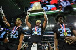 Shadow Creek players Byron Roberson, Terreance Ellis and Terrance Cooks celebrate after winning the 5A Division 1 state championship last year. The Sharks are pegged to win District 23-6A this year by Dave Campbell's Texas Football Magazine.