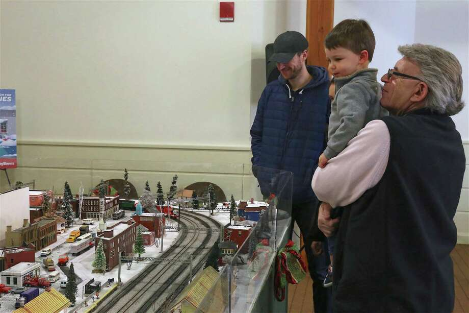 Joseph Rizzo of Greenwich gives his grandson, Julian Chapman, 2, of Westport, a better view at the Holiday Express Train Show at the Fairfield Museum and History Center on Sunday, Dec. 22, 2019, in Fairfield, Conn. Photo: Jarret Liotta / Jarret Liotta / ©Jarret Liotta