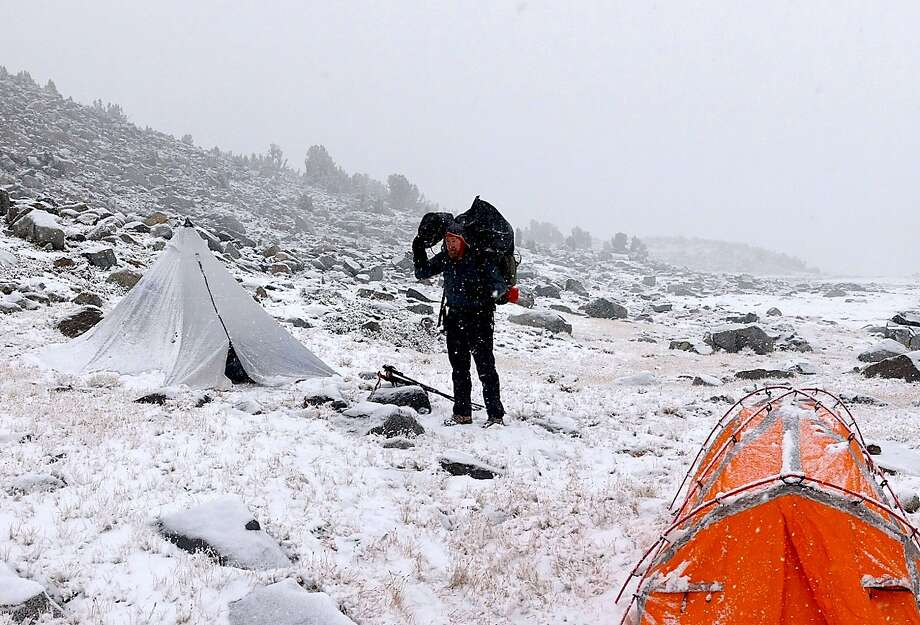 On a fall wilderness trek above tree line in Yosemite National Park, Chronicle outdoors writer Tom Stienstra packed up to trek amid the season's first snowfall. Photo: Josh Helling / Special To The Chronicle