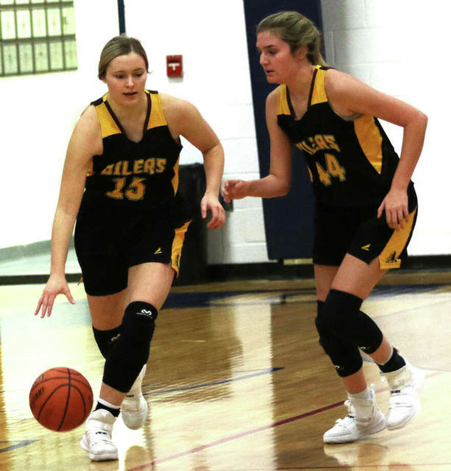 EA-WR's Taylor Parmentier (left) heads upcourt with the basketball alongside teammate Aubrey Robinson during the Oilers semifinal win over Columbia on Thursday at the Candy Cane Classic at Waterloo Gibault. EA-WR won the tourney championship on Saturday with Robinson earning MVP honors and joining Parmentier on the all-tournament team. Photo: Greg Shashack / The Telegraph