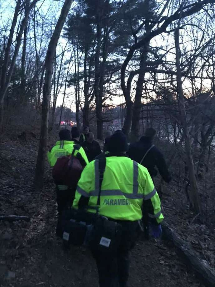 Firefighters and police officers rescued a man and his dog who fell through the ice at Lake Mohegan in Fairfield Sunday. Photo: Fairfield Fire Department Facebook Page / Contributed Photo