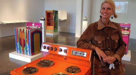 """Katie Pell in 2006 with her Artpace installation """"Bitchen."""" She showed the customized kitchen appliances at car shows as well as in galleries."""