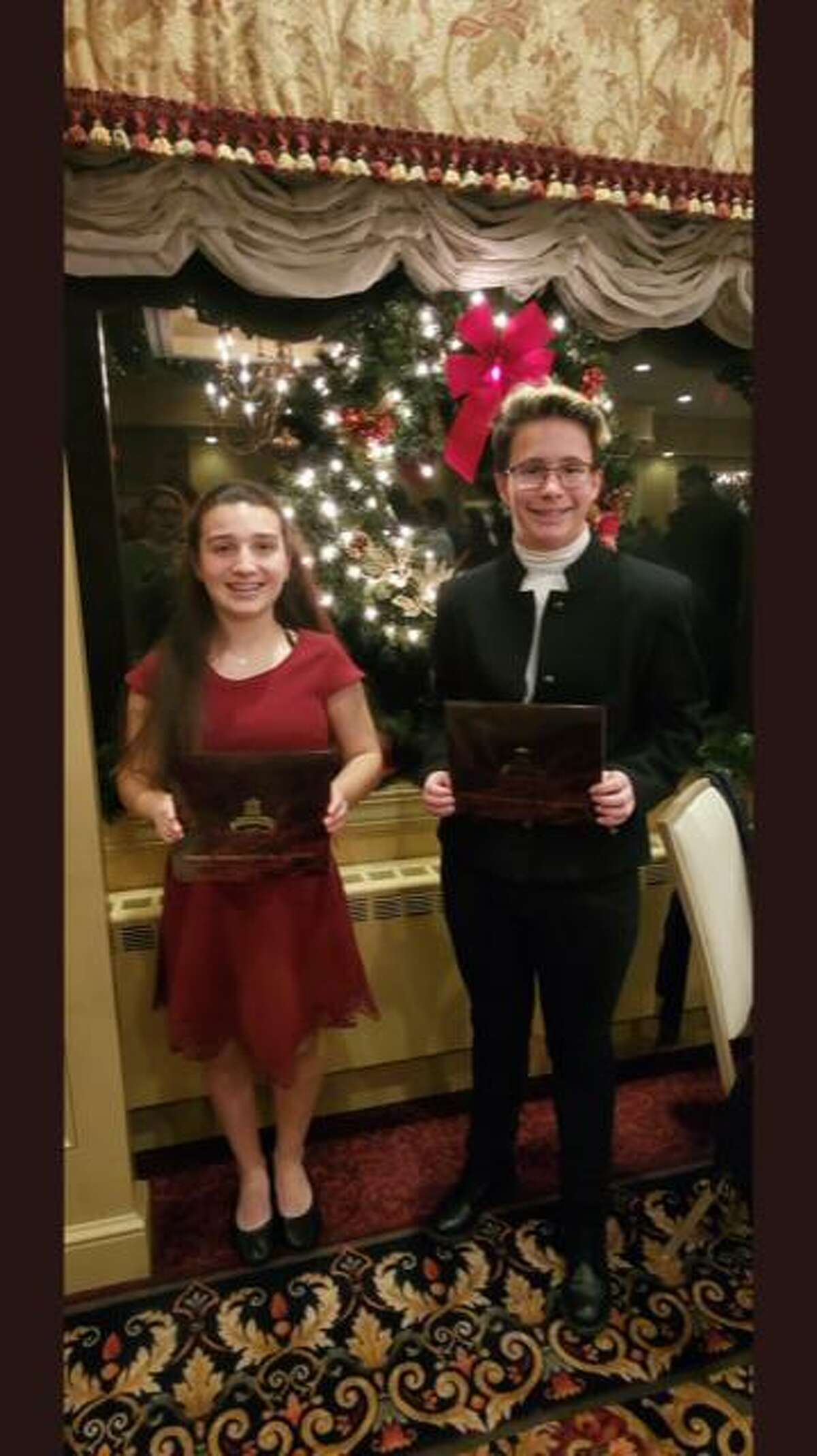 Shelton Intermediate School eighth graders Marissa Manzo and Robin Uhrynowski, who each earned Connecticut Association of Public School Superintendents (CAPSS) Superintendent/Student Recognition Awards earlier this month.