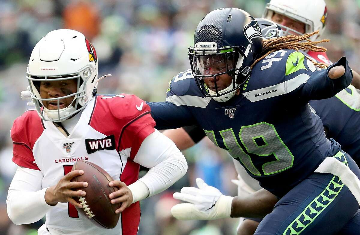 SEATTLE, WASHINGTON - DECEMBER 22: Quarterback Kyler Murray #1 of the Arizona Cardinals scrambles against pressure from outside linebacker Shaquem Griffin #49 of the Seattle Seahawks during the game at CenturyLink Field on December 22, 2019 in Seattle, Washington. (Photo by Abbie Parr/Getty Images)