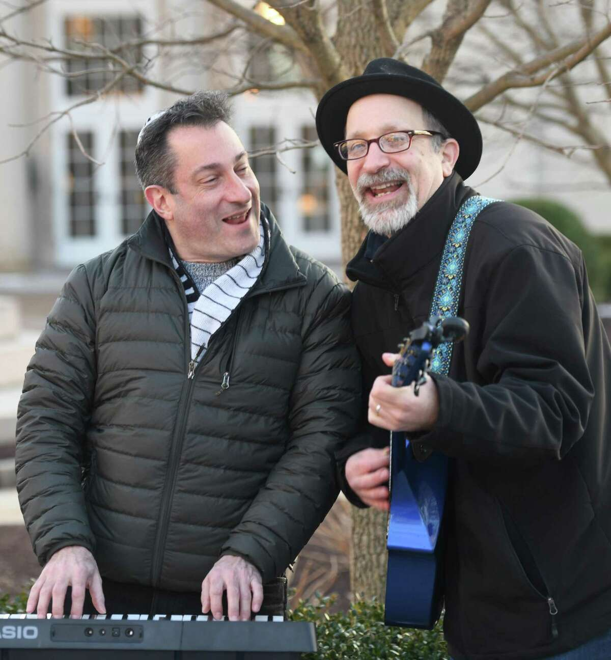 Jonathan Cahr, left, and Booby Doowah perform as the Doowah Diddy Ohs at Chabad of Greenwich's Chanukah Wonderland on Greenwich Avenue in Greenwich, Conn. Sunday, Dec. 22, 2019. Folks celebrated the first night of Chanukah with a giant outdoor menorah lighting, as well as donut decorating, arts and crafts, music, a virtural reality tour, and the Chanukah story as told by Judah Maccabee.