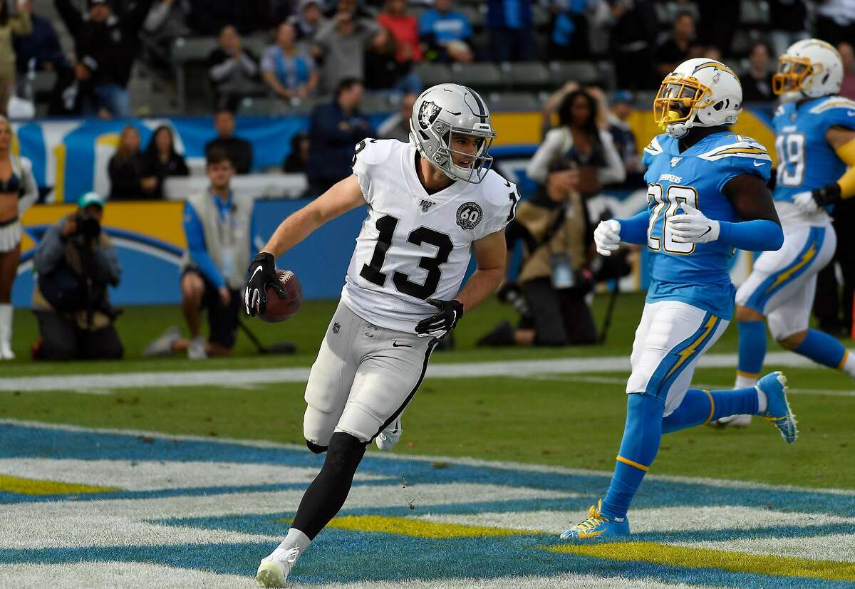 CARSON, CA - DECEMBER 22: Wide receiver Hunter Renfrow #13 of the Oakland Raiders scores a touchdown against against Los Angeles Chargers during the first half at Dignity Health Sports Park on December 22, 2019 in Carson, California. (Photo by Kevork Djansezian/Getty Images)